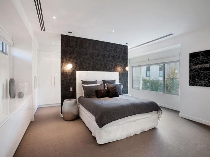 Love the idea of the walk in wardrobe and en suite behind the bed, although this is to small.