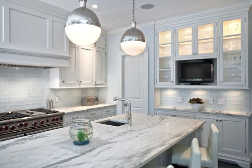 For a contemporary kitchen, paint your cabinets in a frosty-white paint color (a white with grayish undertones) and use an abundance of silver and cool grays around the space.