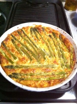 This is the best and CREAMIEST crust-less quiche Ive ever eaten and I eat a lot of quiche! I asked my friend, Michele, to share her recipe with Zaar and she was kind enough to oblige.  Thanks, girlfriend!  Top this yummy quiche with tinned asparagus, chopped bacon, or tinned salmon.  It makes its own crust as it cooks.  Very nice with a green salad on the side.