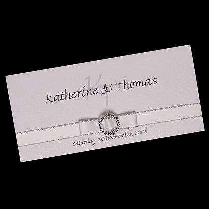 Ribbon Bow with Buckle DL wedding invitation featuring a white ribbon with a sliver border plus a round buckle