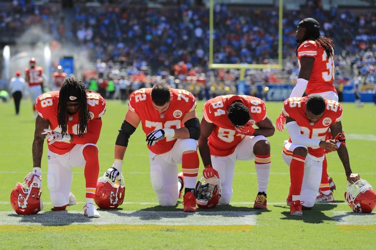 Terrance Smith #48, Eric Fisher #72, Demetrius Harris #84, and Cameron Erving #75 of the Kansas City Chiefs is seen taking a knee before the game against the Los Angeles Chargers at the StubHub Center on September 24, 2017 in Carson, California. (Photo by Sean M. Haffey/Getty Images)