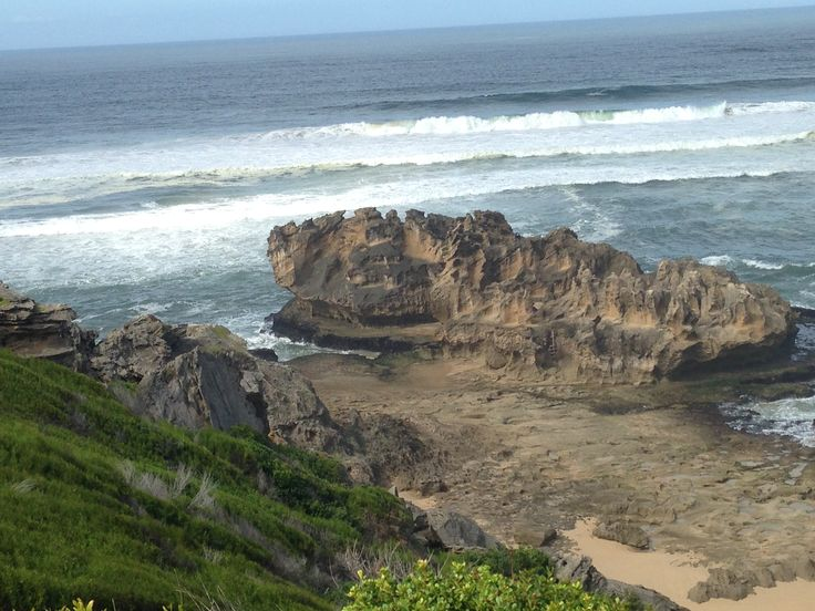 Castle Rock, the best fishing site, from Brenton on Sea Chalets