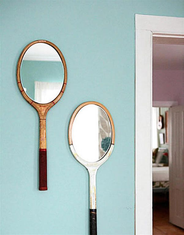 Glue mirrors over the strings of some vintage squash racquets. Great idea for a kids room…