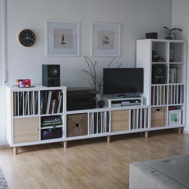 This entertainment center was built using KALLAX storage shelves and BRYNILEN bed legs.