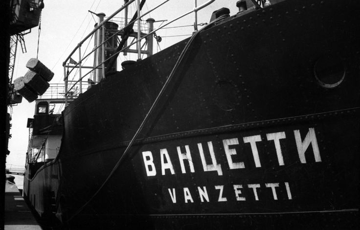 Loading the Vanzetti, 1931. A cargo ship named after Italian-American anarchist and human rights agitator Bartolomeo Vanzetti, executed in the US in 1927. Unloading imported cotton destined for textile factories from the freighter Vanzetti in Leningrad port. Leningrad, Russia