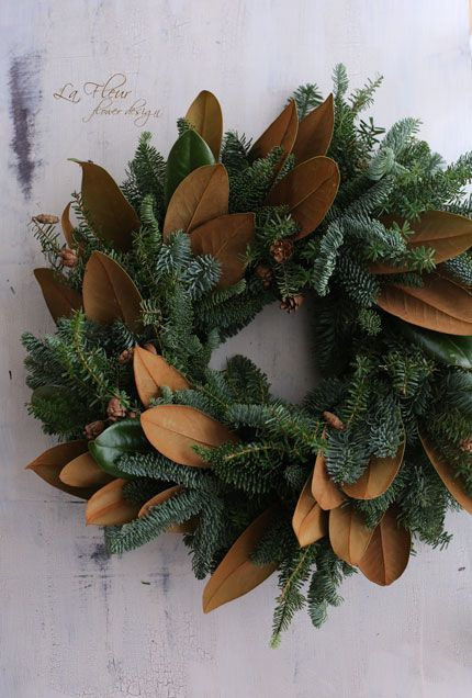 Mix magnolia leaves in with faux evergreen wreath.