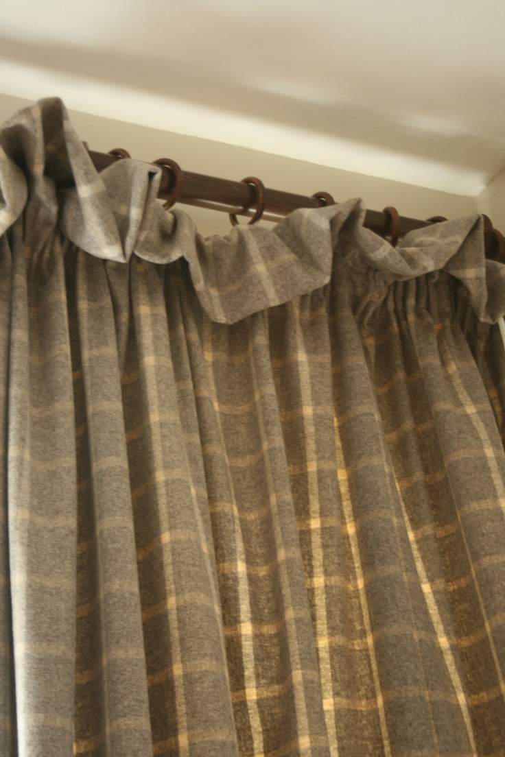 James Brindley Grey wool check with soft frill heading makes a gorgeous warm door curtain Melanie Downing Interiors