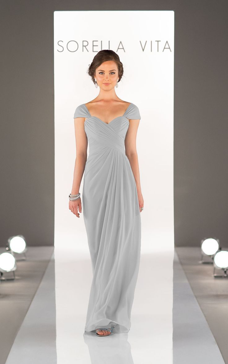 Elegant and feminine, turn up the romance in this Chiffon cap-sleeve bridesmaid dress. The criss-cross sweetheart bodice flows gracefully to the floor.