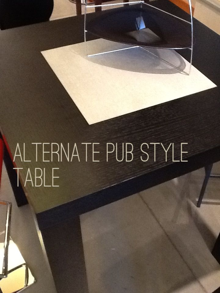 Add a new twist on your dining space with a pub style table.