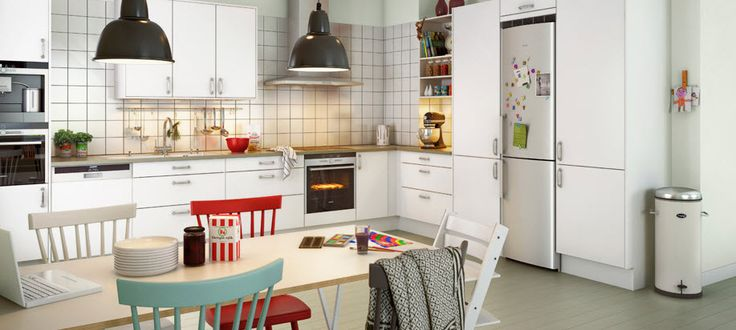 white cabinet colourful kitchen chairs