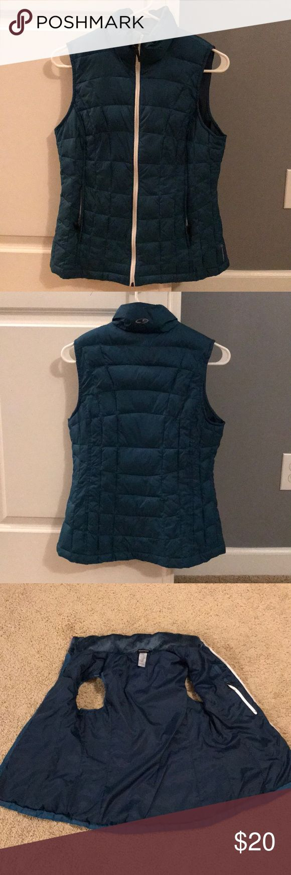 Champion Puffer Athletic Running Down Vest Champion Puffer Athletic Running Down Vest, size small. Dark green color with reflective zipper. Has 2 pockets outside and one inside with a loop near collar to hold earbud wires. Color is soft material. Great for running bib cold or lounging. In excellent condition, worn twice. Champion Jackets & Coats Vests