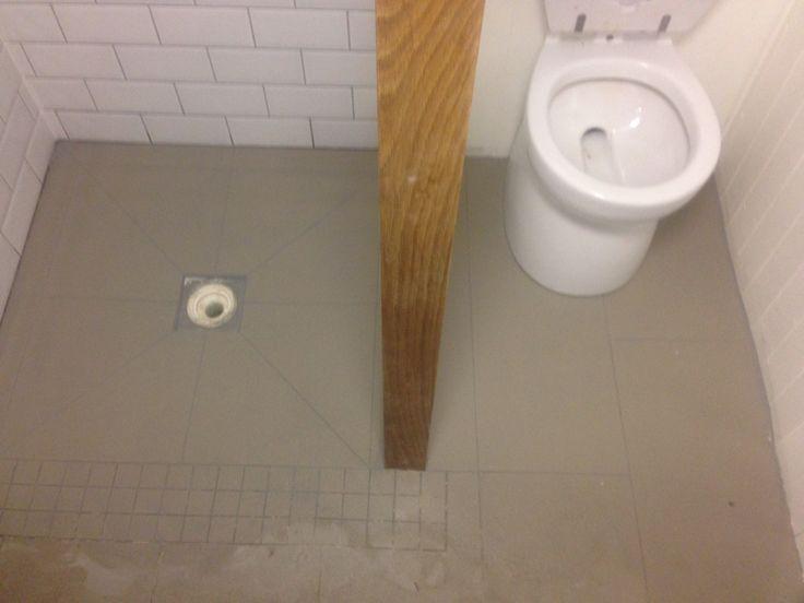 Shower tray and bathroom floor tiles laid onto Marmox board.