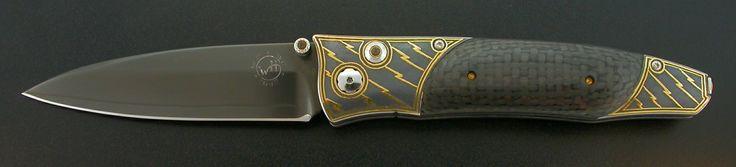Serial #: 1230-0177 001/100 Blade: Tungsten DLC-coated ZDP-189 core stainless @ HRC 67 Frame: Koftgari - Inlaid 24K gold Scale/Inlay: Carbon fiber Gemstone: Smoky Quartz  B30-Bolt $1,300.00