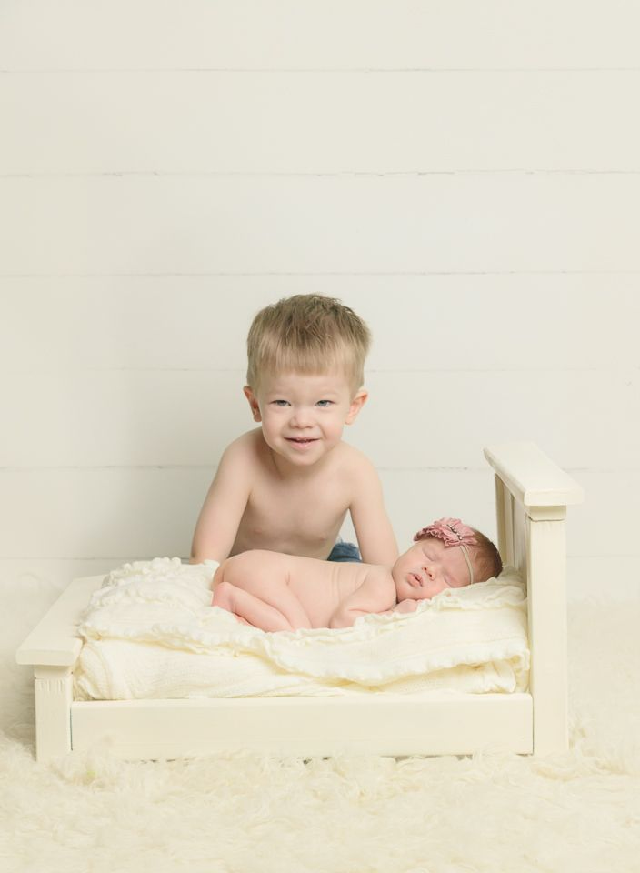 Sibling newborn photo of brother and baby sister newborn photography in fort lauderdale fl