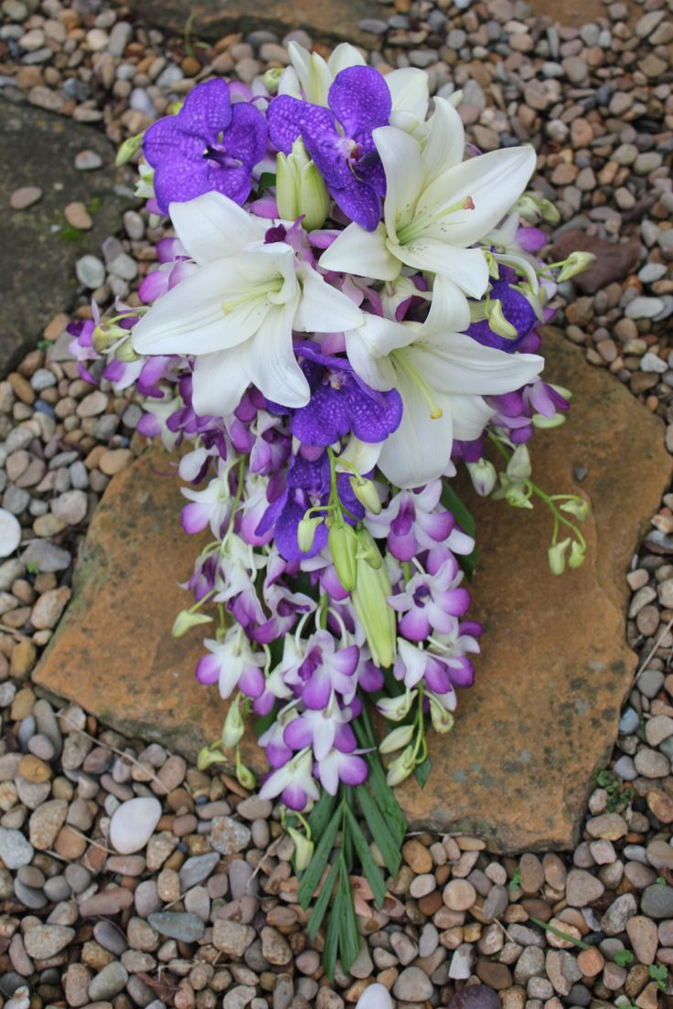 Open Trail wedding Bouquet with Lily and Orchids. Created by Poppies and peas Floral Design.