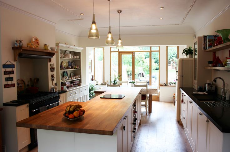 Rustic family kitchen renovation with an island unit.  For a free consultation call: 0113 262 5954 http://www.redesignexperts.co.uk/