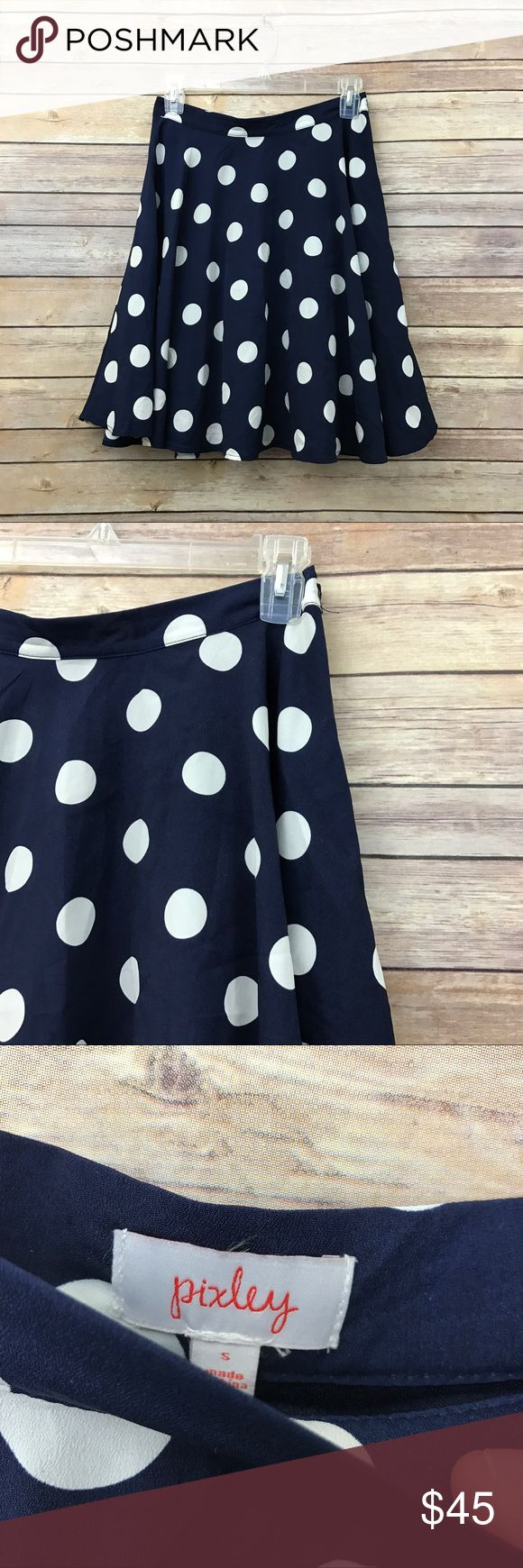 """Pixley Stitch Fix blue & wht polka dot skirt S 55 This super adorable classic navy blue skirt with white polka dots is by Pixley which is a Stitch Fix brand. It is a women's size small and measures 14"""" flat across the waist with a length of 20"""". It is in excellent preowned condition with no known flaws and light overall wear. Pixley Skirts Circle & Skater"""
