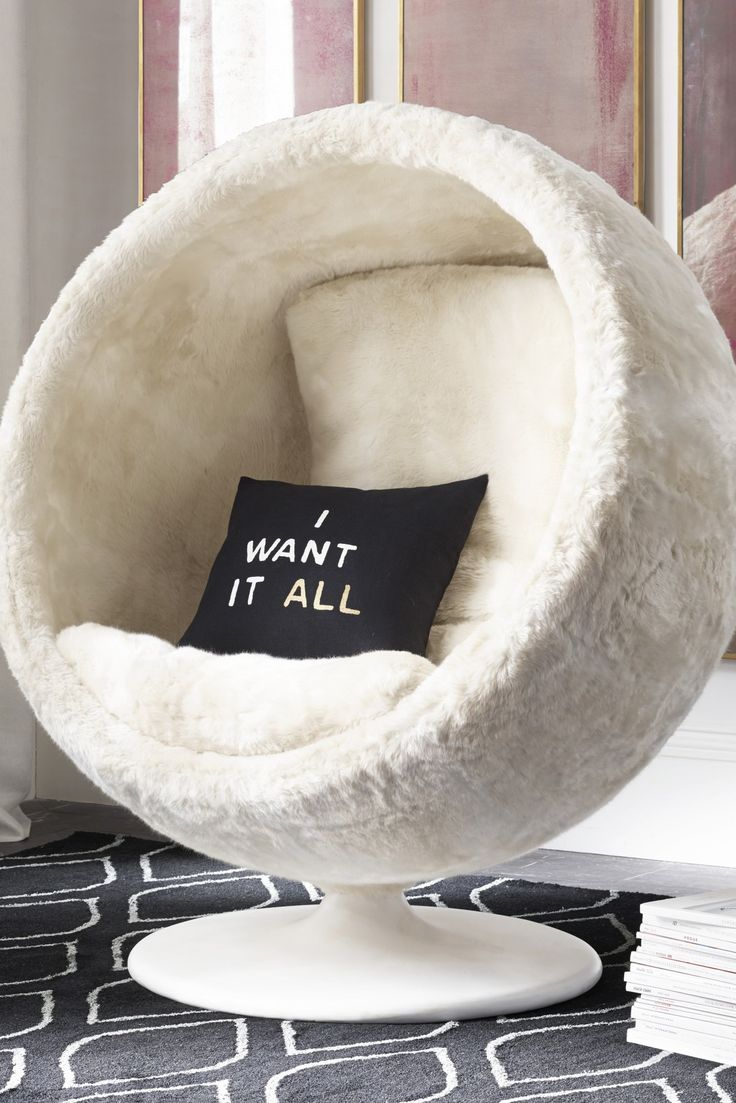 Didn't we warn you that you might want it all? Orbit faux fur chair, available in three colors and shown in arctic white ($1,799) and expressions pillow cover and insert available in five styles ($46-$54).
