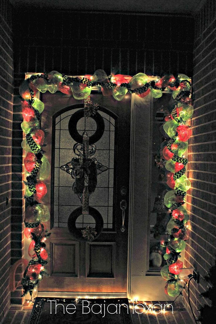 deco mesh wreaths with license plates | The deco mesh garland all light up and on the porch with the three ...