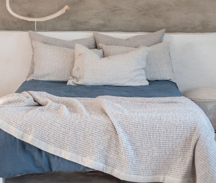 A selection of Waffle, Nantucket and Cottage pillowcases on a Denim duvet cover.  A Camargue throw in Oats adds the finishing touch