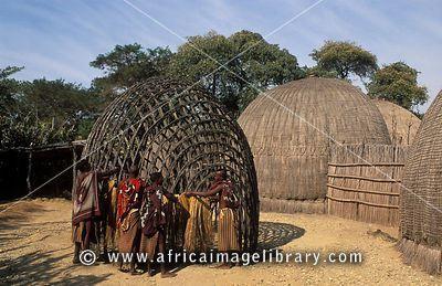 Swazi boys thatching a beehive hut, Matsamo village, Swaziland