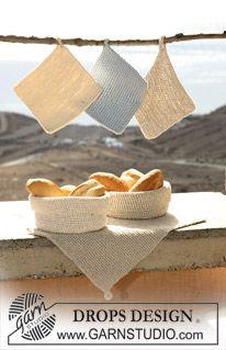 """Settet består av: DROPS rillestrikket kjøkkenhåndkle med innfelt hempe i """"Bomull-Lin"""", heklet brødkurv i """"Bomull-Lin"""" og """"Cotton Viscose"""" og rillestrikket gryteklut med innfelt hempe i """"Ice"""" eller """"Bomull-Lin"""". ~ DROPS Design"""