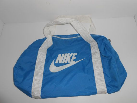 Check out this item in my Etsy shop https://www.etsy.com/listing/247745500/vintage-80s-blue-small-nike-duffle-bag