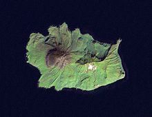 """Ekarma (Russian: Экарма; Japanese 越渇磨島; Ekaruma-tō) is an uninhabited volcanic island near the center of the Kuril Islands chain in the Sea of Okhotsk in the northwest Pacific Ocean, separated from Shiashkotan by the Ekarma Strait. Its name is derived from the Ainu language, from """"safe anchorage""""."""