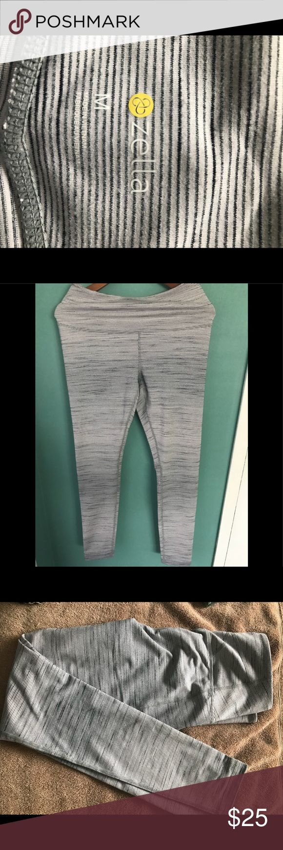 Zella workout pants Size M Zella workout pants; high waisted (great for holding in the tummy): color is gray with subtle black and white stripes; pants are ankle length; has pocket in waist for keys; never worn but took off the tags; for reference I'm 5'7 and 135 lbs and they fit great!  This is an awesome deal! Zella Pants Track Pants & Joggers