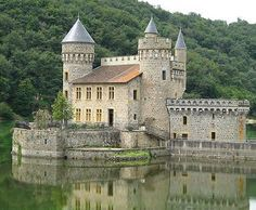 Château de La Roche, Saint-Priest-la-Roche, Loire département, France .... http://www.castlesandmanorhouses.com/photos.htm The castle stands on an island in the lake formed by the Villerest dam . It was built on a rocky platform overlooking the Loire river from a height of 30 metres. During the 1930s, the construction project for the Villerest dam by EDF condemned the château to disappear below the water. It was bought for one franc by the commune and is now situated on an island.