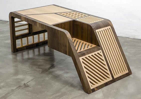 Aquila Coffee table inspired by eagle wings in a spread position. Solid wood is often replaced by lattice surfaces that refer to the skeleton underneath the bird's feathers. american walnut-maple 600mmX1300mmX550mm