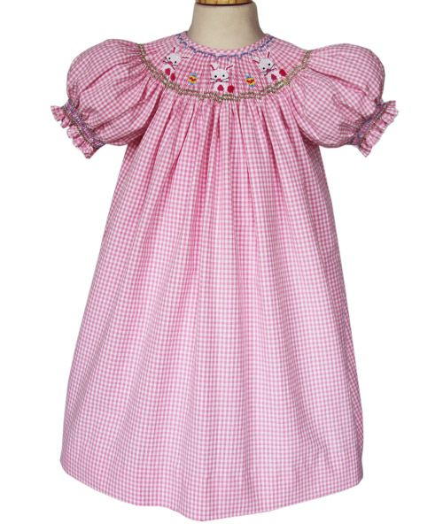 Our Lindsey girls bunny Easter dress is absolutely adorable and perfectly Springy! It is a pretty pink gingham bishop with hand smocked little Easter bunnies and Easter eggs along the neckline. This l