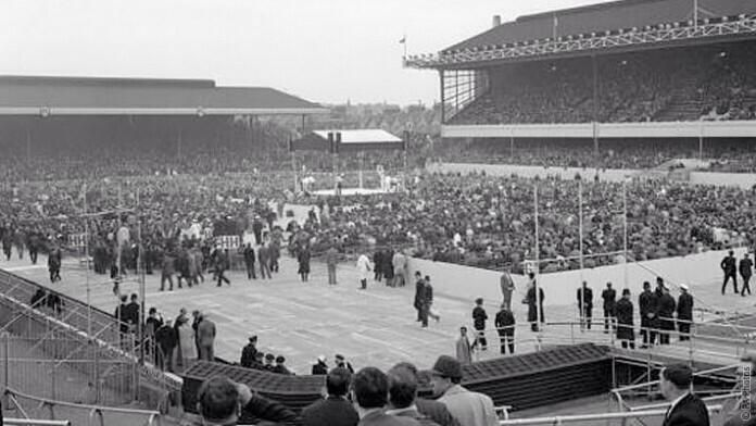 A crowd of 46,000 watches Henry Cooper vs Muhammad Ali at Highbury 1966.