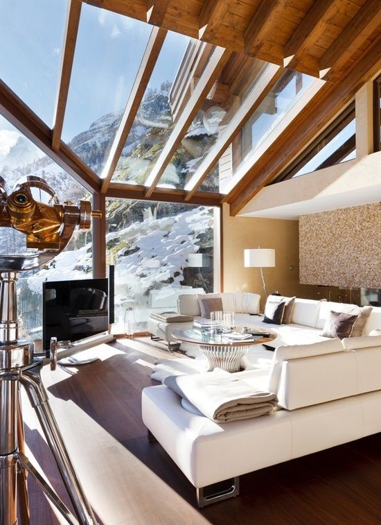 The natural light plus the comfiness. Incredible view! Chalet Zermatt Peak in the Swiss Alps.
