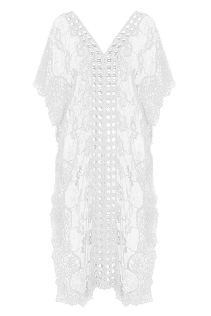 Καφτάνι με βαμβάκι και δαντέλα με κέντημα.Χαλαρή εφαρμογή.Ύψος μοντέλου: 1,75m65% Cotton 35% Polyester
