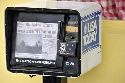 A newspaper dispenser outside the ''yellow diner''.