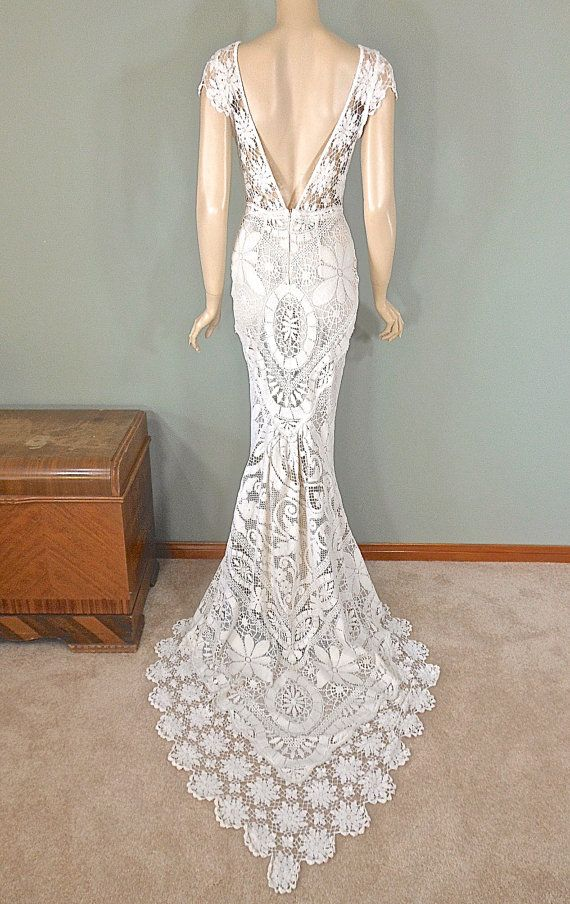 Truly an off white, bohemian wedding dress, made from vintage laces. Incredible details. Stunning, vintage hand crocheted sheer lace yoke in front,