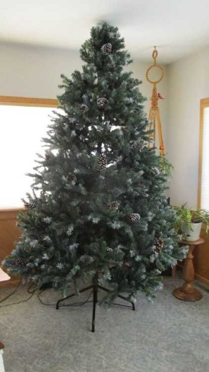Artificial nine foot Christmas Tree It is a long needle pre-lite