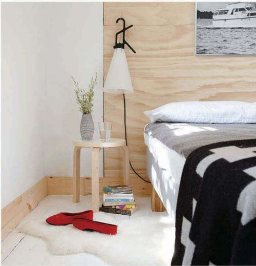 Plywood headboard and wooden stool bedside table