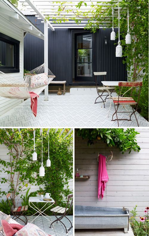 Home outdoor in Los Feliz, LA with black_walls, pergola, cobblestone_paving and hammok