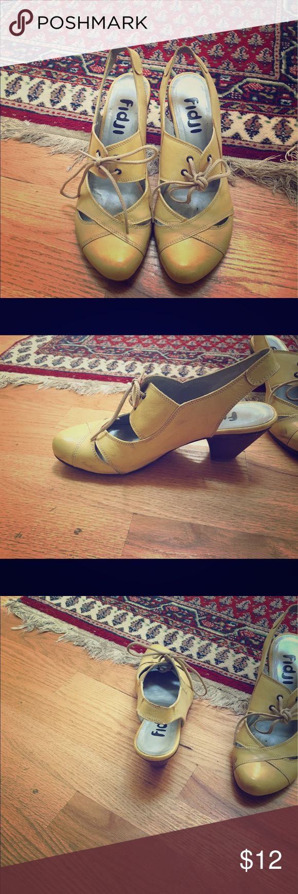 Vintage shoes! Vintage yellow small heeled shoes! Would look great with any summer outfit! Slight scuff on side, could be polished out. Contact me for more info fidji Shoes Heels