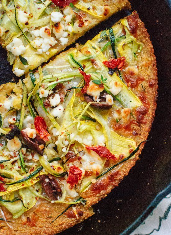 This summer squash and feta pizza has a socca base — a simple, savory, crispy pancake made with just chickpea flour, water, olive oil and salt.