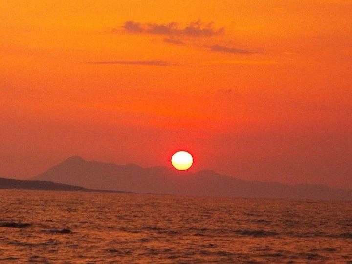 Sunset in Agios Stefanos Beach, Corfu.