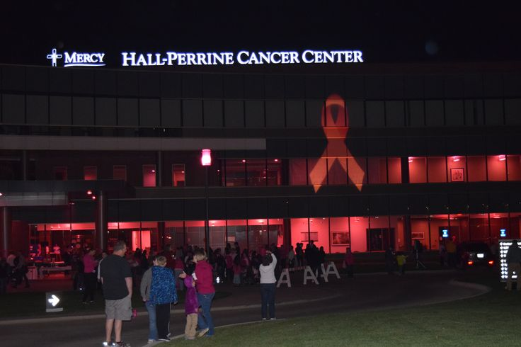 Hall-Perrine Cancer Center in Cedar Rapids, IA, lighting the night pink for breast cancer awareness month.
