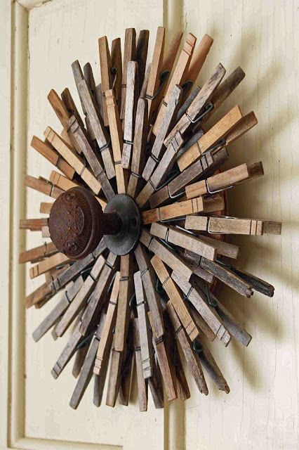 DIY Clothespin Starburst Wall Hanging. The old doorknob in the center makes this a nifty little coat rack, or possibly a place to hang necklaces or scarves...?