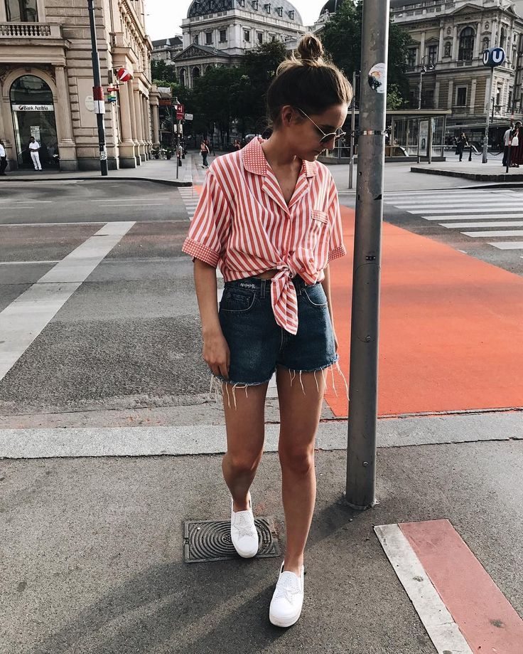 casual summer outfit | red and white stripes | short sleeve blouse | dark denim shorts | white tennis shoes | streets | city