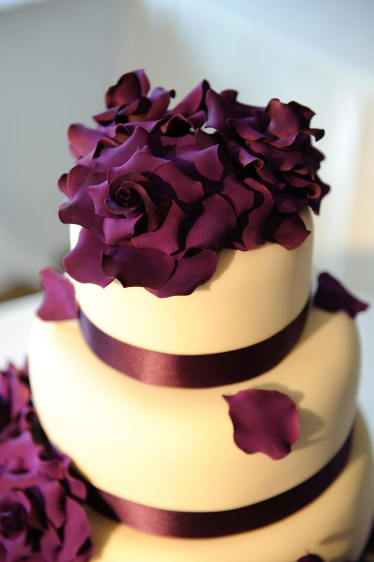Tiered wedding cake; fondant; deep purple satin ribbon and deep purple petal topper