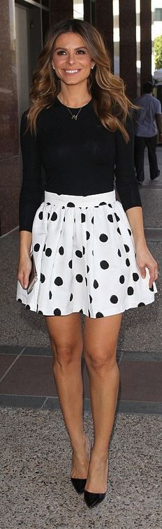 Who made Maria Menounos'  black long sleeve top, ombre nude pumps, white polka dot skirt, and jewelry?