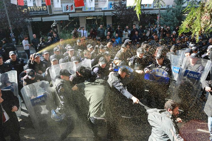 Turkish riot police officers use tear gas and arrest demonstrators during a protest against the arrest of pro-Kurdish Peoples' Democratic Party (HDP) lawmakers, in Ankara, on Nov. 4, 2016