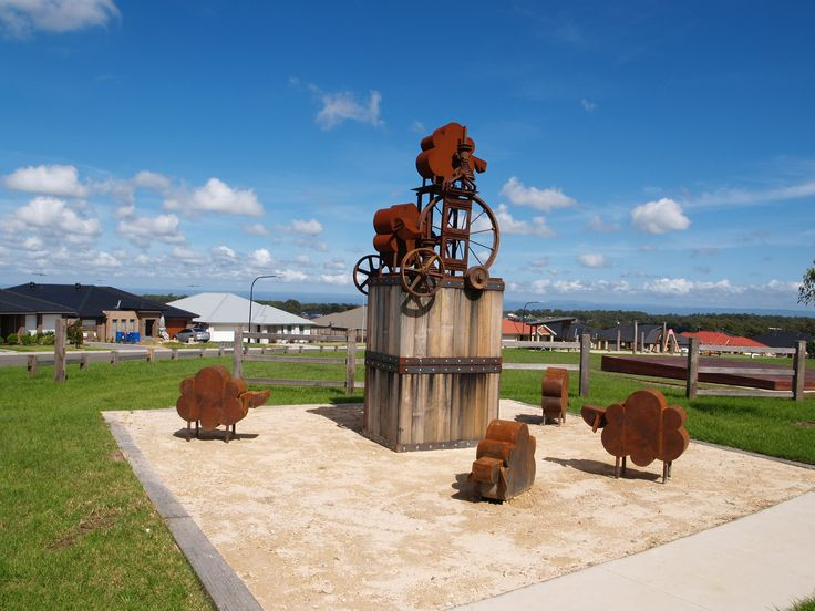 """""""Sheepish"""" 2012 Wood, Corten Steel, Cast Iron and Mild Steel. Public commission at Merivale Rise, Kellyville Ridge, Australia. The parts used in the sculpture were from an old woolpress found on this exact site. The sculpture pays homage to the history of the area and the wool industry which helped Australia to prosper."""